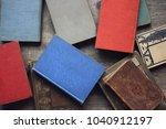old vintage book stack over... | Shutterstock . vector #1040912197