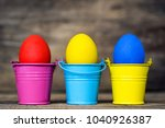 easter eggs in colored buckets  ...   Shutterstock . vector #1040926387