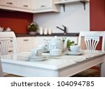 kitchen interior with  dishes  on table  (beautiful Depth Of Field effect) - stock photo