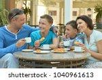 family having breakfast together | Shutterstock . vector #1040961613