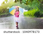 Kid Playing Out In The Rain....