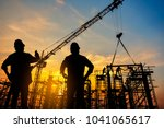 Small photo of silhouette construction worker Concrete pouring during commercial concreting floors of building in construction site and Civil Engineer or Construction engineer inspec work