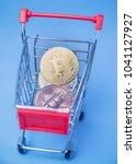 bitcoin in shopping cart for... | Shutterstock . vector #1041127927