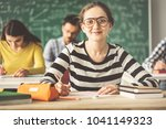 students in classroom sitting... | Shutterstock . vector #1041149323