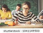 students in examination solving ... | Shutterstock . vector #1041149503