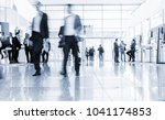 blurred people at a trade fair... | Shutterstock . vector #1041174853