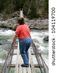 Obese woman on suspension bridge - stock photo