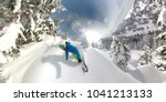 360 OVERCAPTURE: Freeride snowboarder riding fresh powder snow in snowy mountain forest. Sportsmen in winter clothing snowboarding freshly fallen snow in backcountry wilderness. Sunny winter vacation