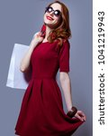 redhead woman i red dress with... | Shutterstock . vector #1041219943