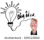 Businessman drawing light bulb with big idea isolated on white background. - stock photo