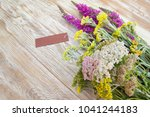 flowers and card on the table ... | Shutterstock . vector #1041244183