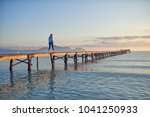 woman walking away from the... | Shutterstock . vector #1041250933