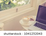 computer laptop and coffee in... | Shutterstock . vector #1041252043