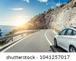 white car rushing along a high... | Shutterstock . vector #1041257017