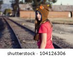 Grungy image of a teen walking on the railroad tracks - stock photo