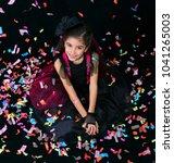 cute girl sitting on the floor... | Shutterstock . vector #1041265003