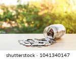 coin in glass bottle pour on... | Shutterstock . vector #1041340147