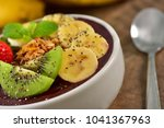 frozen acai berry bowl with... | Shutterstock . vector #1041367963
