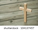wooden cross on wood background | Shutterstock . vector #104137457