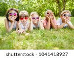 childrean as team on the grass...   Shutterstock . vector #1041418927