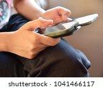 girl transferring data from one ...   Shutterstock . vector #1041466117
