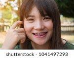 asian women happy smile cute... | Shutterstock . vector #1041497293