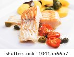 cod fillets with olives and... | Shutterstock . vector #1041556657