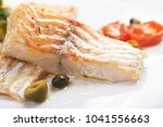 cod fillets with olives and... | Shutterstock . vector #1041556663