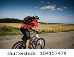 young man cycling Cross-country (XC) - stock photo