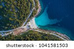 aerial view of marble beach.... | Shutterstock . vector #1041581503