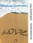 sea waves in the sand with love ... | Shutterstock . vector #1041632707