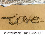 sea waves in the sand with love ... | Shutterstock . vector #1041632713