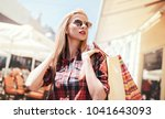 woman in shopping. woman with...   Shutterstock . vector #1041643093