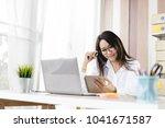 asian beautiful girl working...   Shutterstock . vector #1041671587