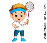 young boy playing badminton | Shutterstock . vector #1041673093