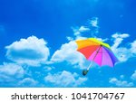 umbrella on blue sky | Shutterstock . vector #1041704767
