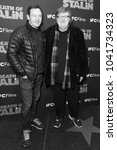 Small photo of New York, NY - March 8, 2018: Jason Isaacs and Michael Moore attend New York premiere of IFC Film Death of Stalin at AMC Lincoln Square