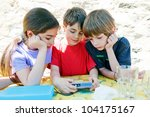 three children looking at the... | Shutterstock . vector #104175167