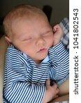 a cute newborn baby sleeps in... | Shutterstock . vector #1041802543