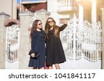 the walk of the girls to autumn | Shutterstock . vector #1041841117