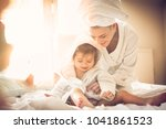 happy young mother playing on... | Shutterstock . vector #1041861523