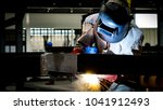 welding with sparks by process... | Shutterstock . vector #1041912493