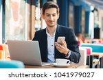 multitasking. smiling young... | Shutterstock . vector #1041979027