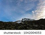 summit of mount kilimanjaro... | Shutterstock . vector #1042004053