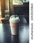 capuchino fresh ice coffee with ... | Shutterstock . vector #1042025863