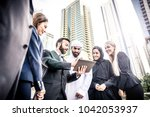 arabic and western business... | Shutterstock . vector #1042053937
