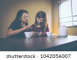 mother and daughter lifestyle... | Shutterstock . vector #1042056007