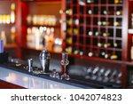 bartender pouring fresh... | Shutterstock . vector #1042074823