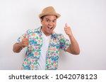 happy young asian man wearing... | Shutterstock . vector #1042078123