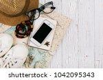 smartphone lies on a notebook... | Shutterstock . vector #1042095343